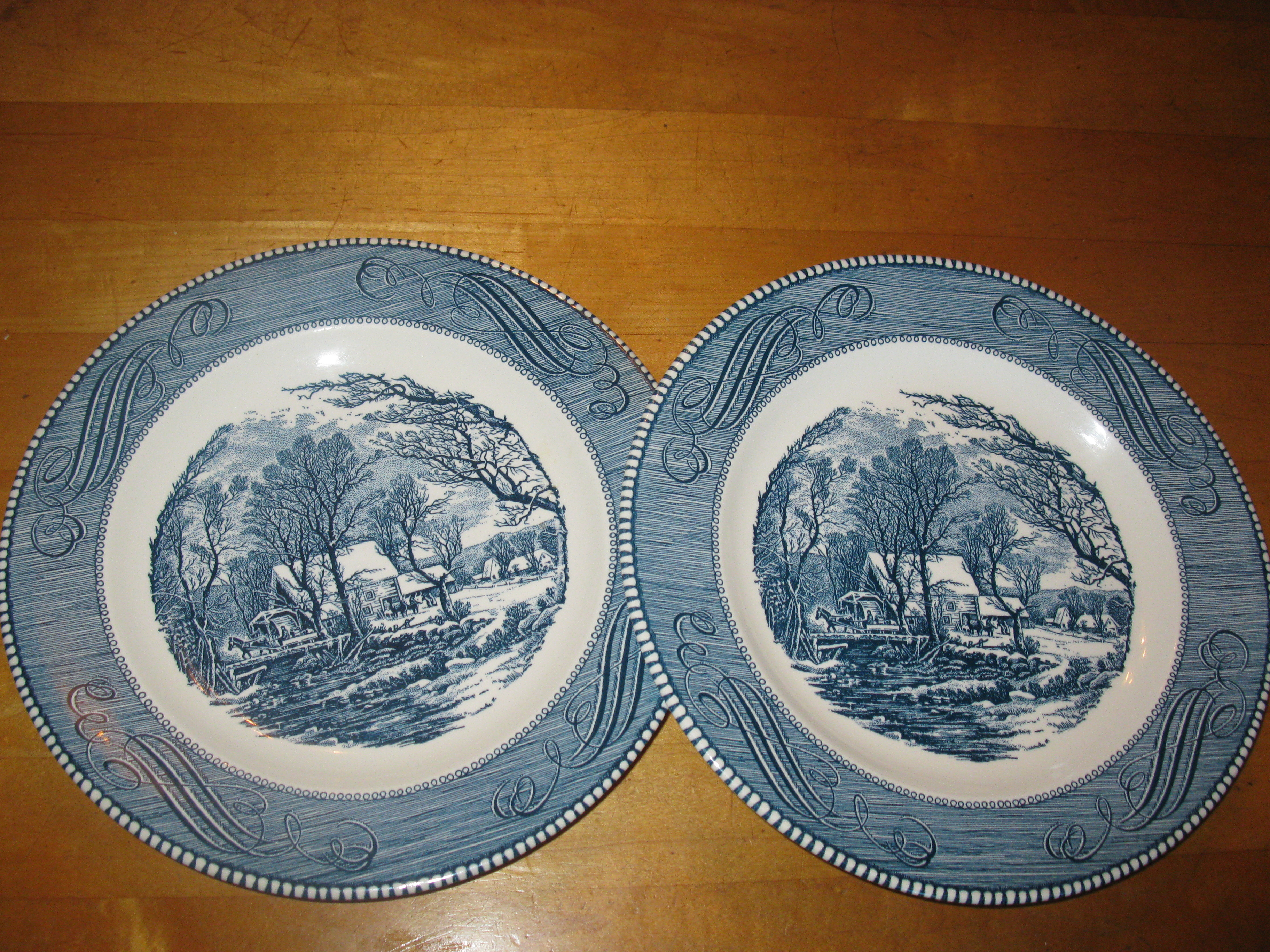 White picture plates in perfect condition currier and ives plates
